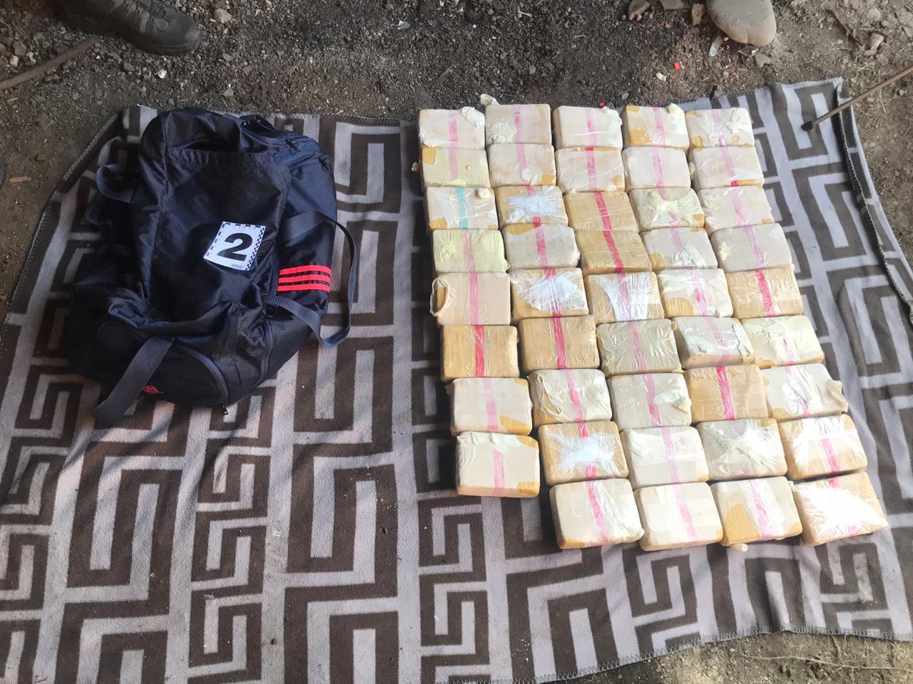 Закарпатському наркокур'єру, вдома у якого знайшли близько 130 кг героїну, погоджено підозру (ФОТО), фото-4